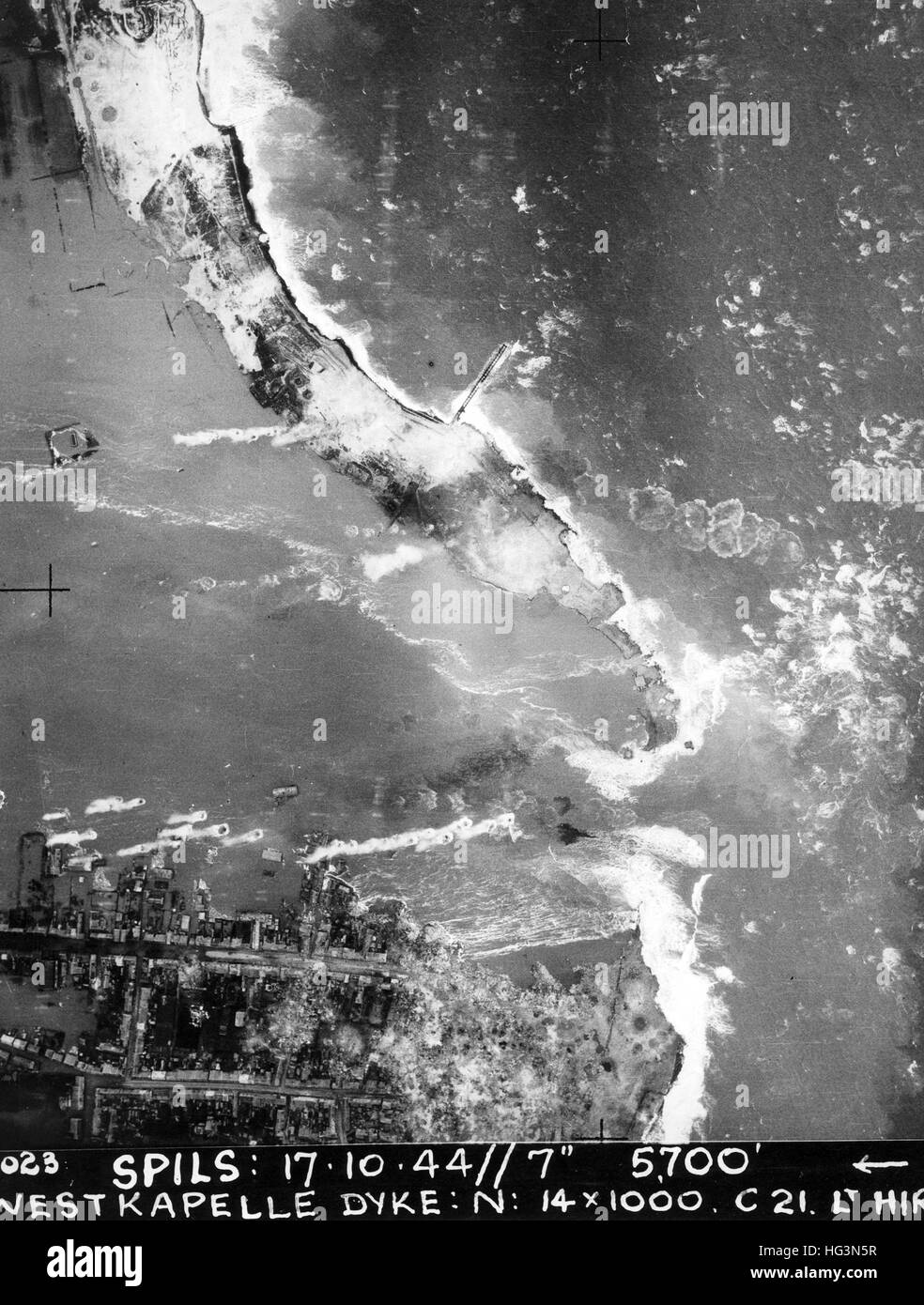 HOLLAND WW2 - RAF reconnaissance photo from 5700 ft showing breaks in the dykes at Westkapelle and flooding inland - Stock Image
