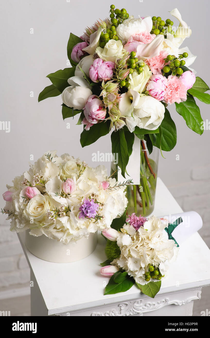 Bouquet of white peonies flower composition on white table bouquet bouquet of white peonies flower composition on white table bouquet paper box vase in the background izmirmasajfo