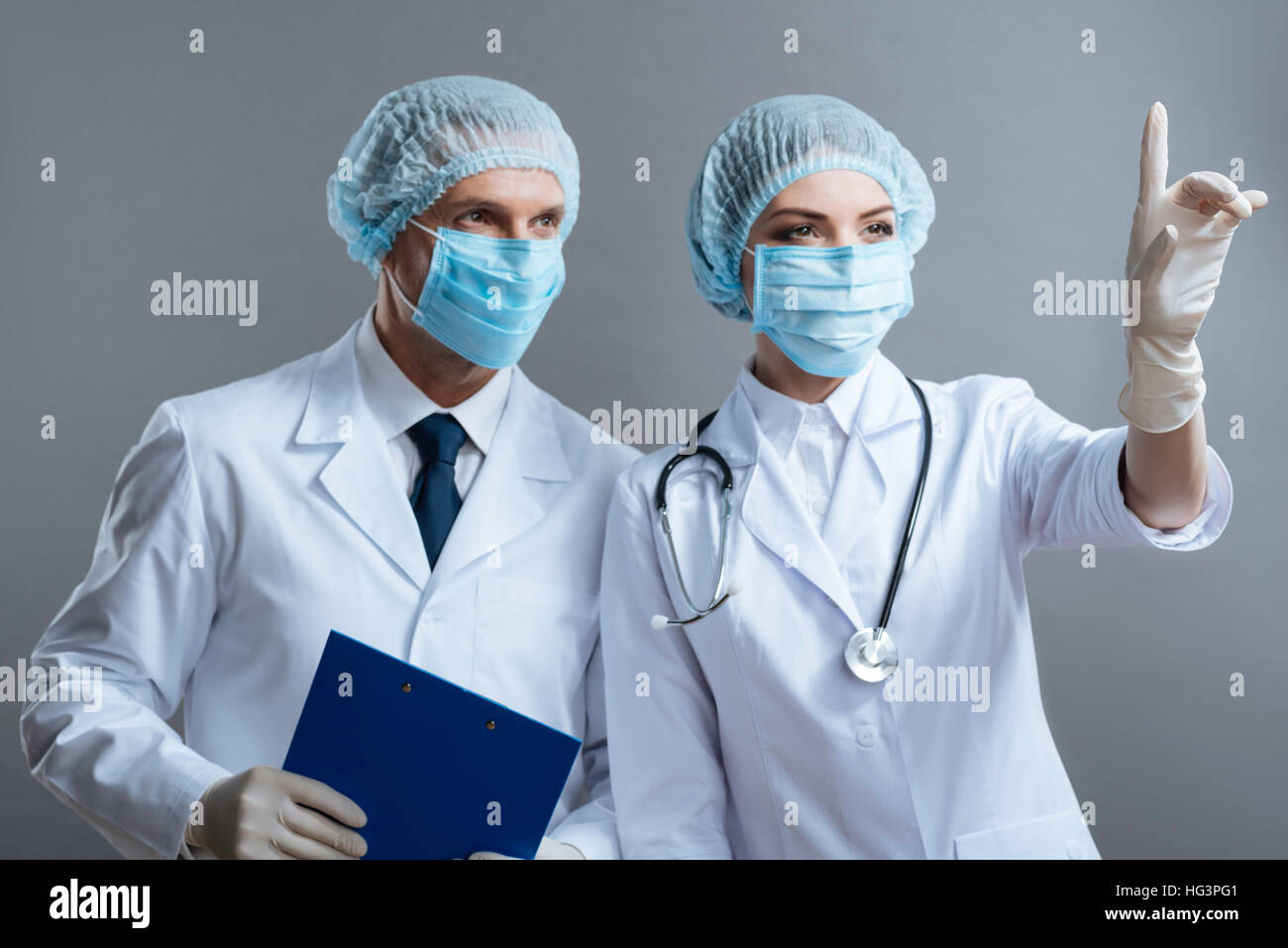 Man and woman working as doctors together - Stock Image