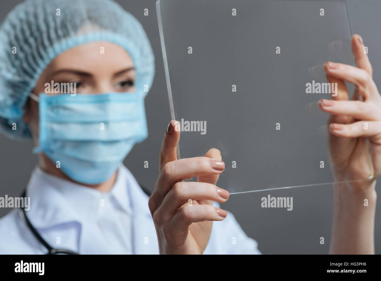 Beautiful woman using medical glass - Stock Image
