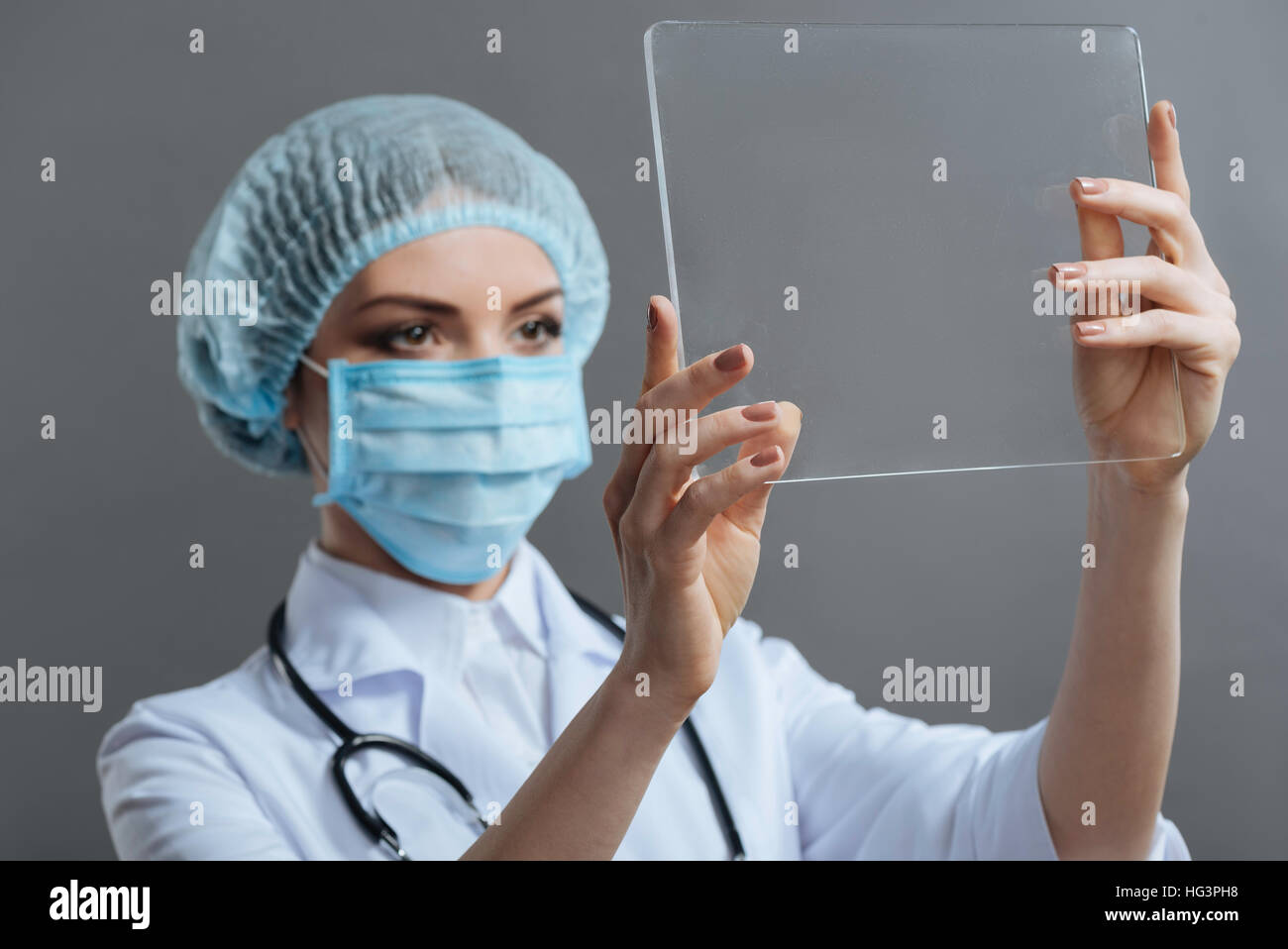 Beautiful woman discovering medical glass - Stock Image