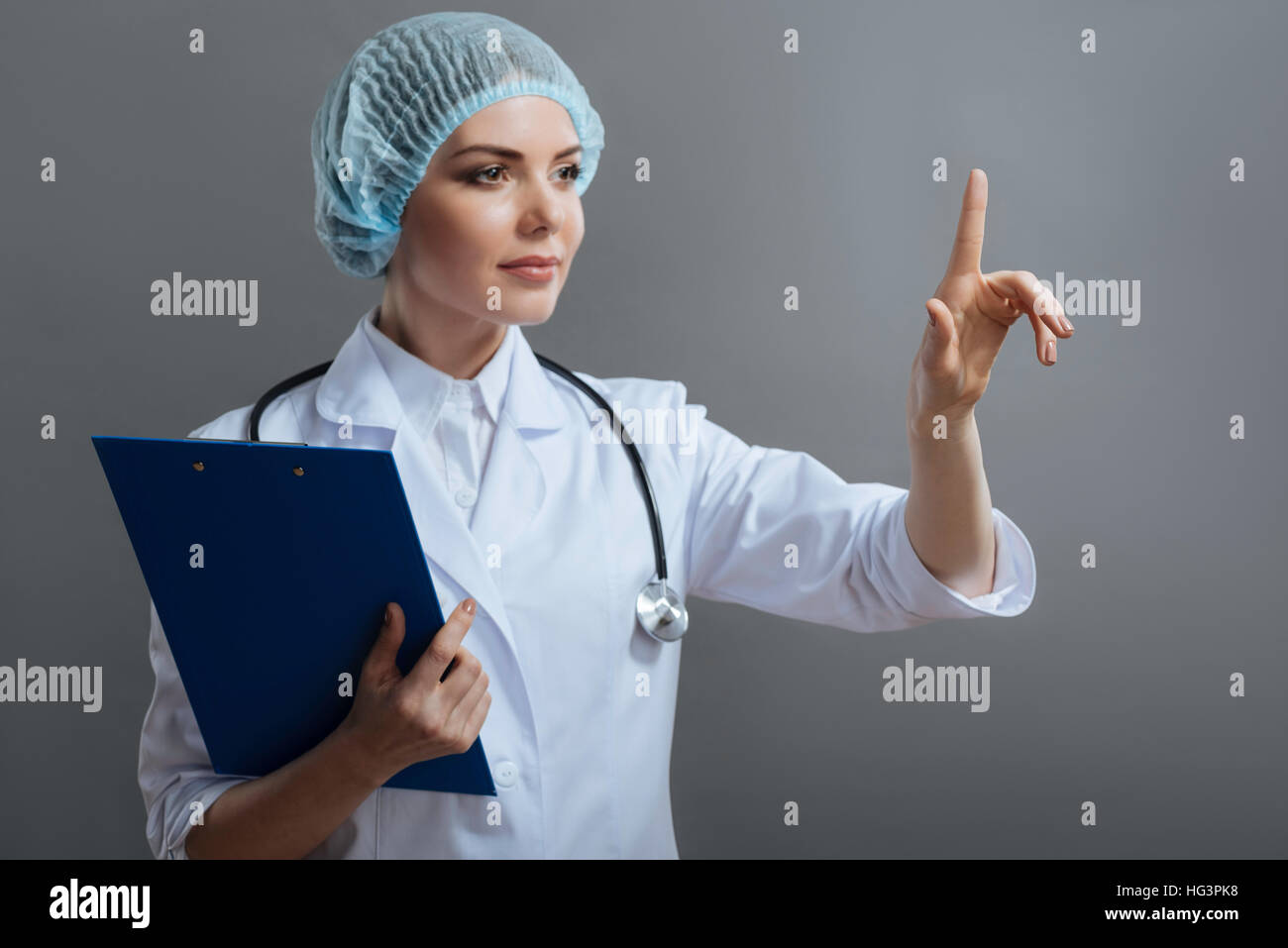 Female doctor holding medical documents - Stock Image