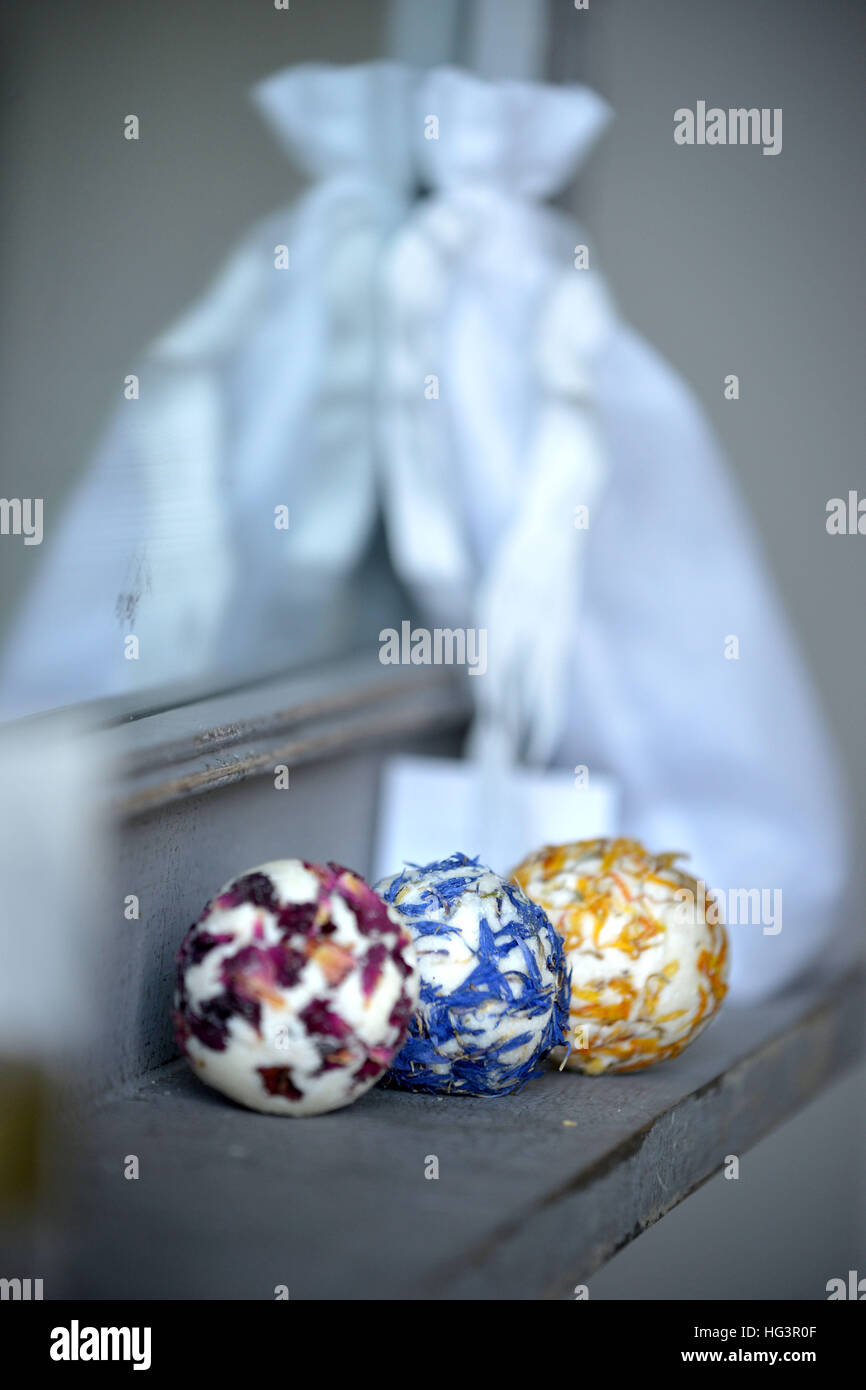 Bath bombs made with real flower petals in a bathroom - Stock Image