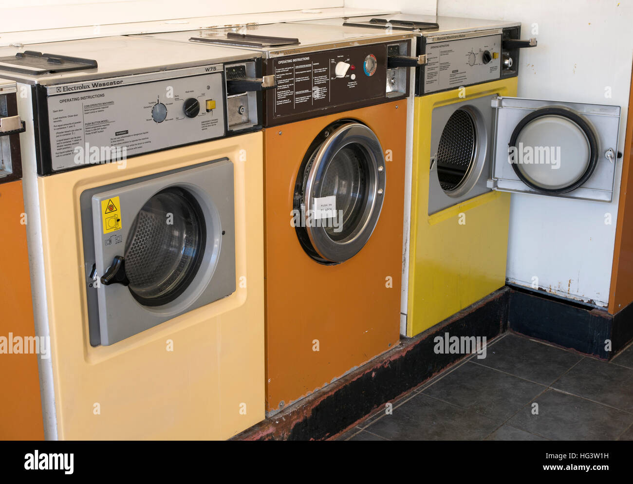 Colourful washing machines in a laundrette in Pool Cornwall, England UK. - Stock Image