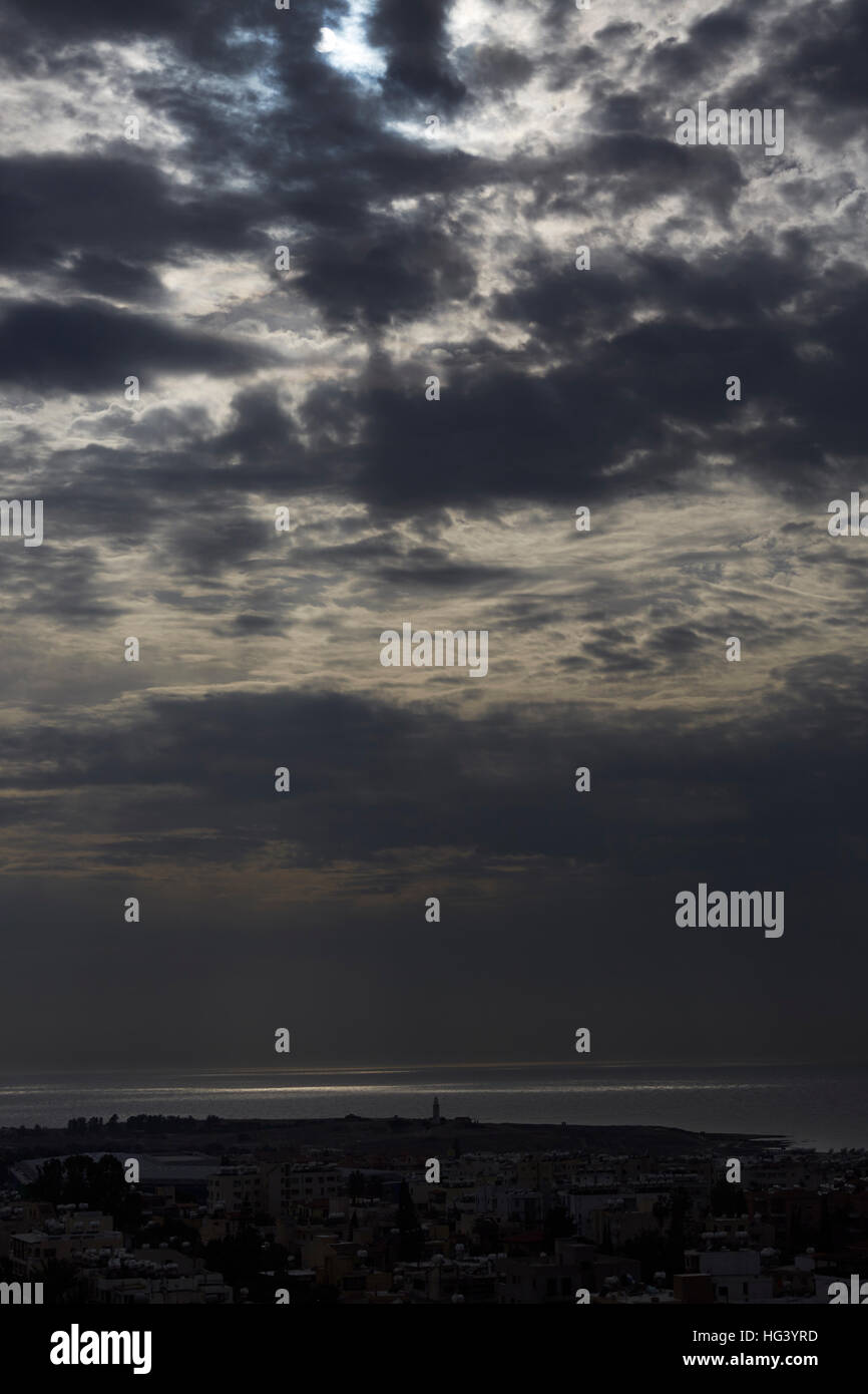 Paphos, Cyprus. View towards the ocean under a cloudy sky. - Stock Image