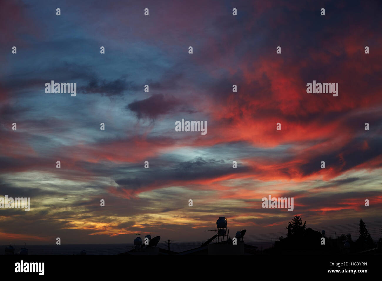 Paphos, Cyprus. Dramatic sky at sunset. - Stock Image
