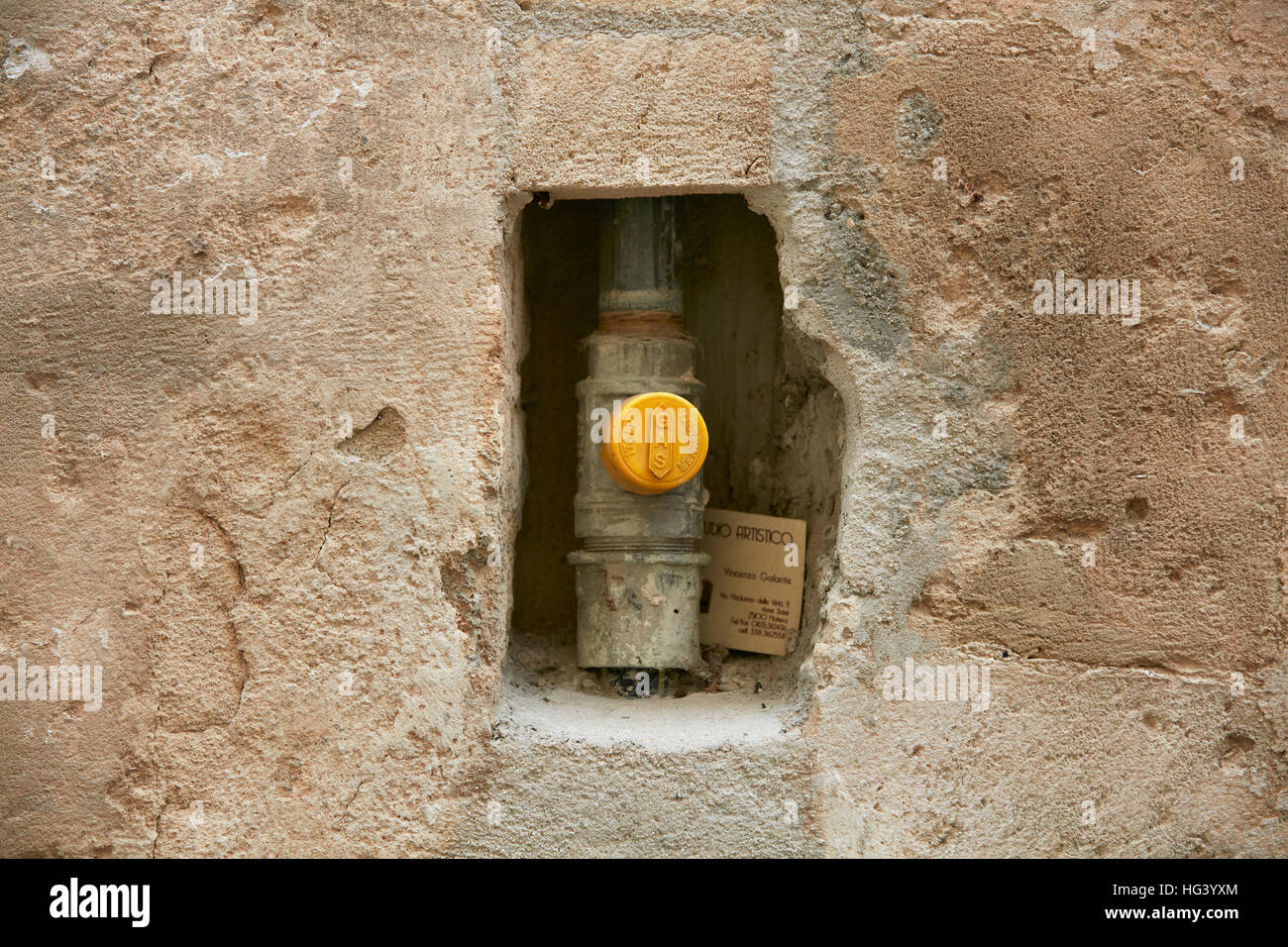 Matera, Italy. Close up of a water meter in a wall niche. - Stock Image