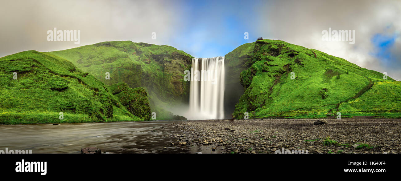 Panorama of the famous Skogafoss waterfall in southern Iceland. Long exposure. - Stock Image