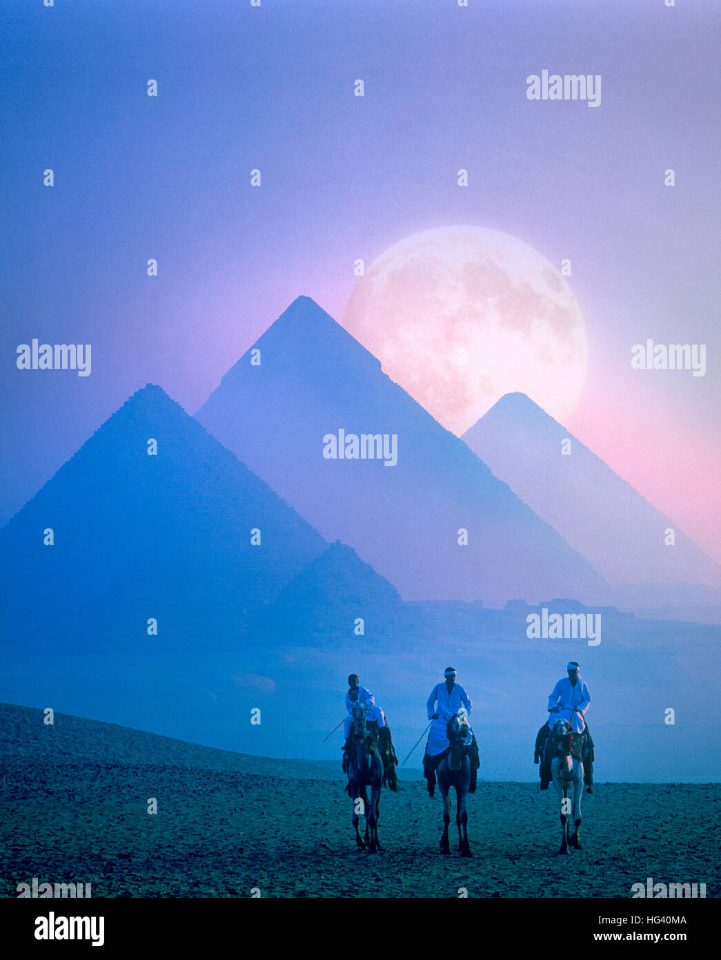 Full moon rising behind the Pyramids at dusk, Giza, Cairo, Egypt - Stock Image