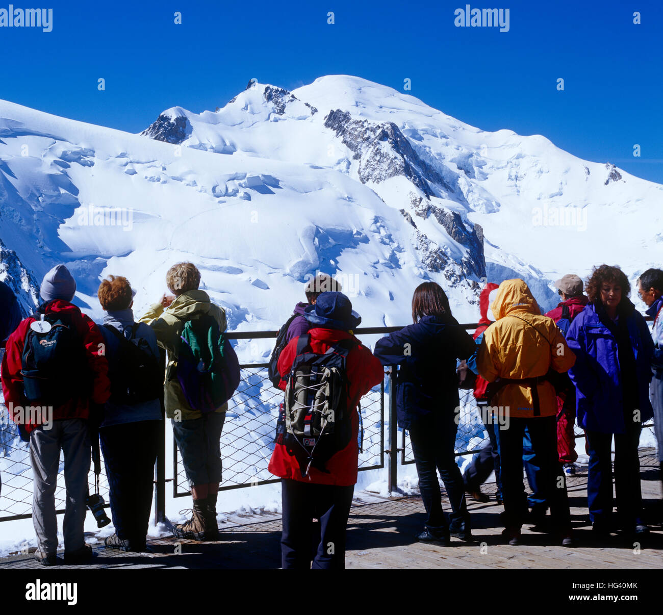 Tourists viewing Mont Blanc from Aguile du Midi, France - Stock Image