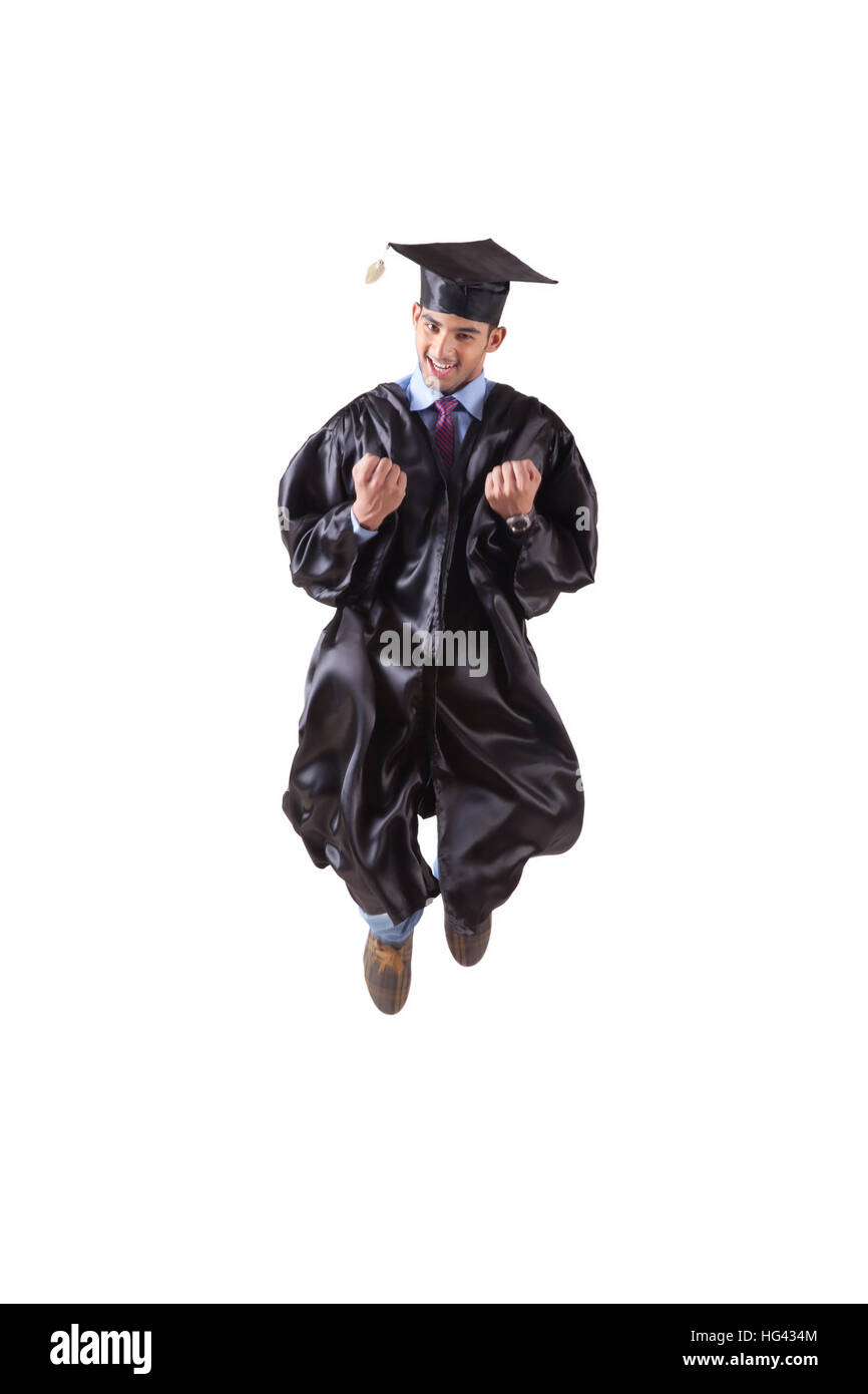 Young Male graduate student jumping out of joy - Stock Image