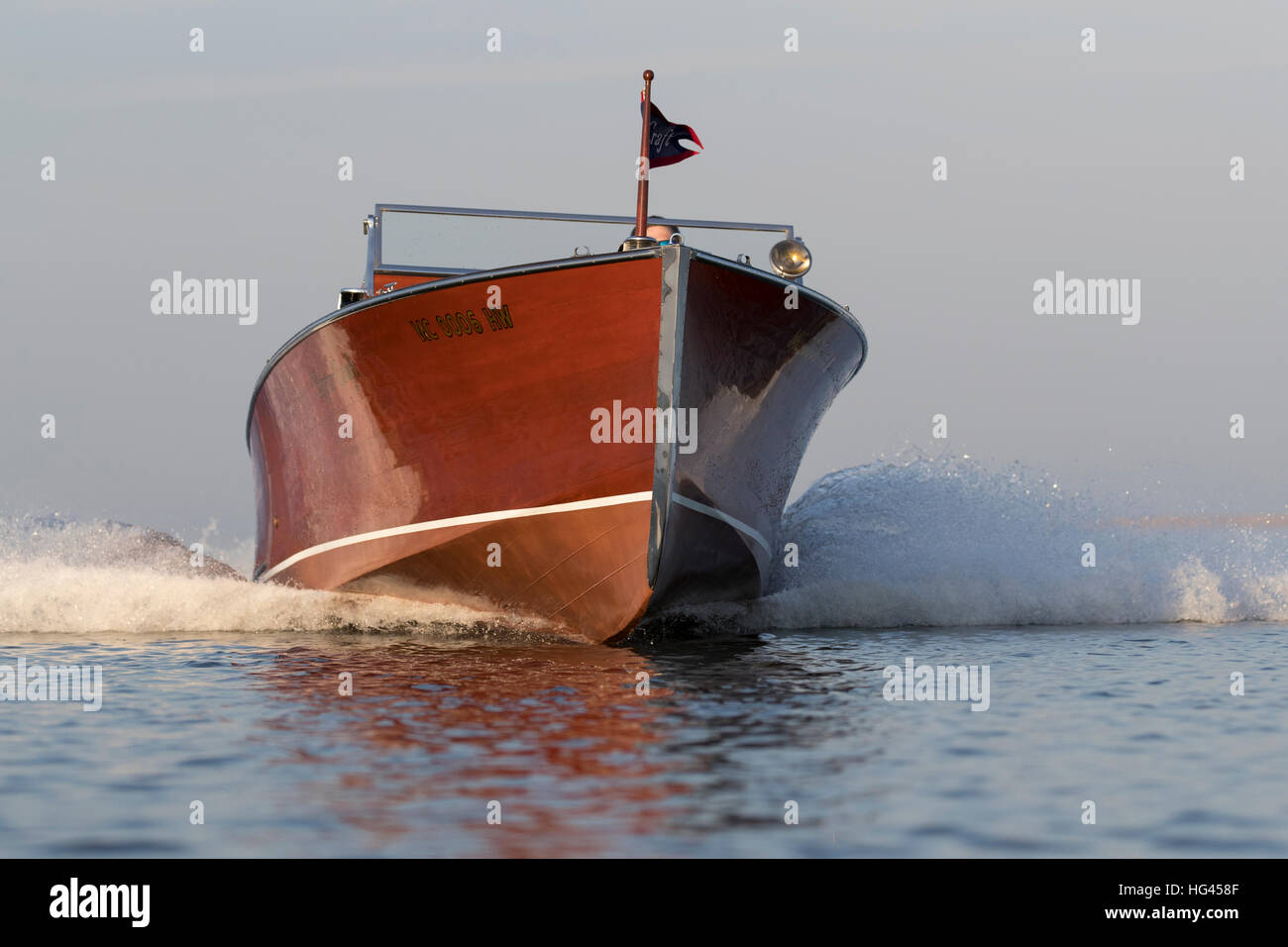 A fast approaching wood speedboat. - Stock Image