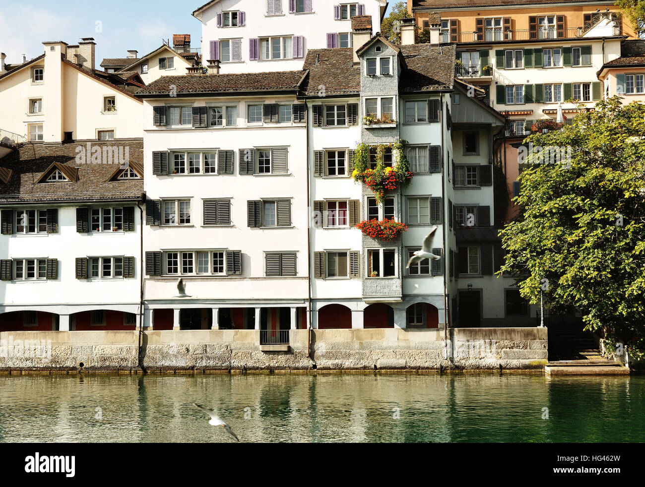Zurich, Switzerland - view of typical swiss white house near river Limmat - Stock Image