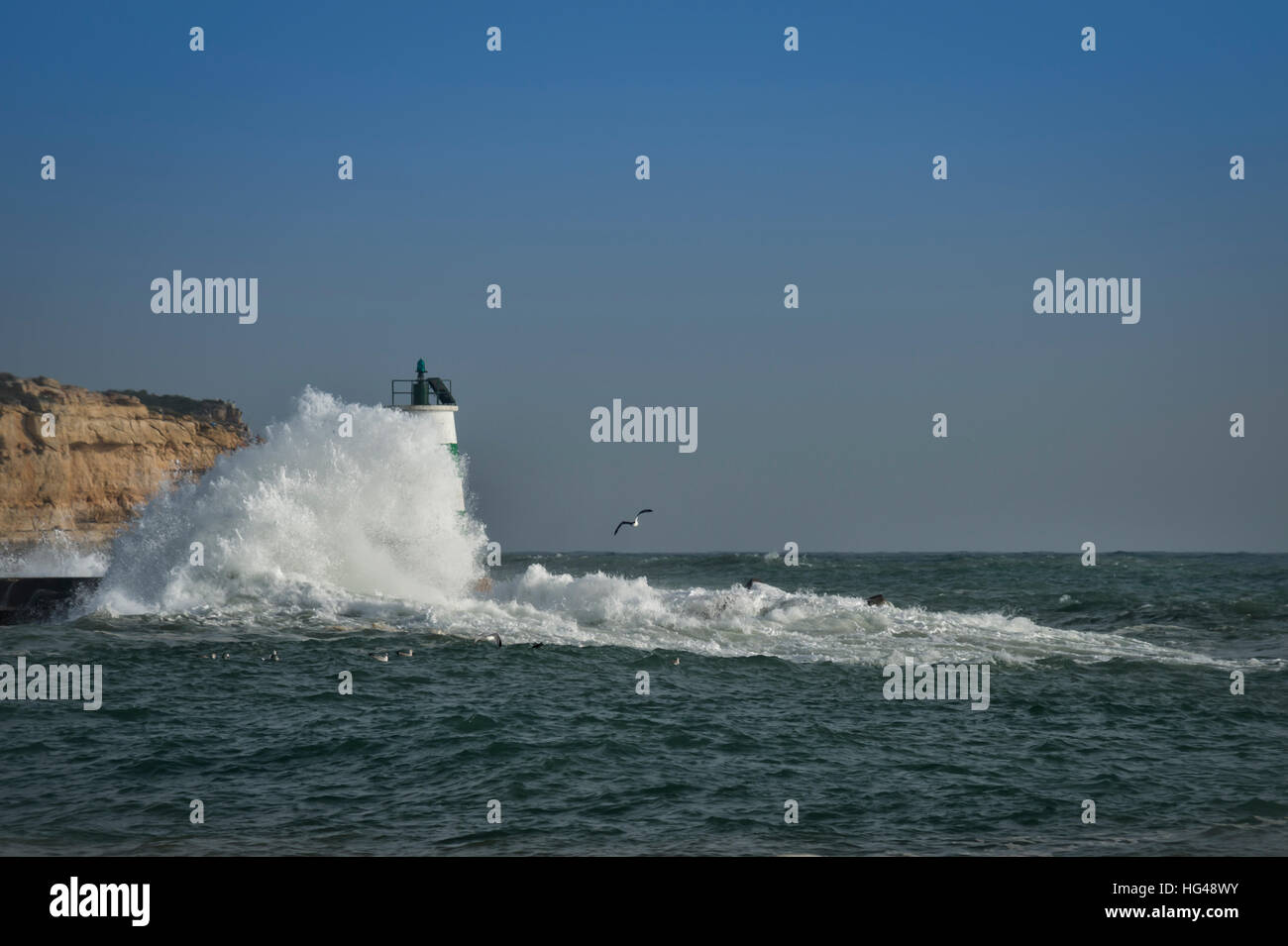 Portimao navigation mark with crashing waves - Stock Image