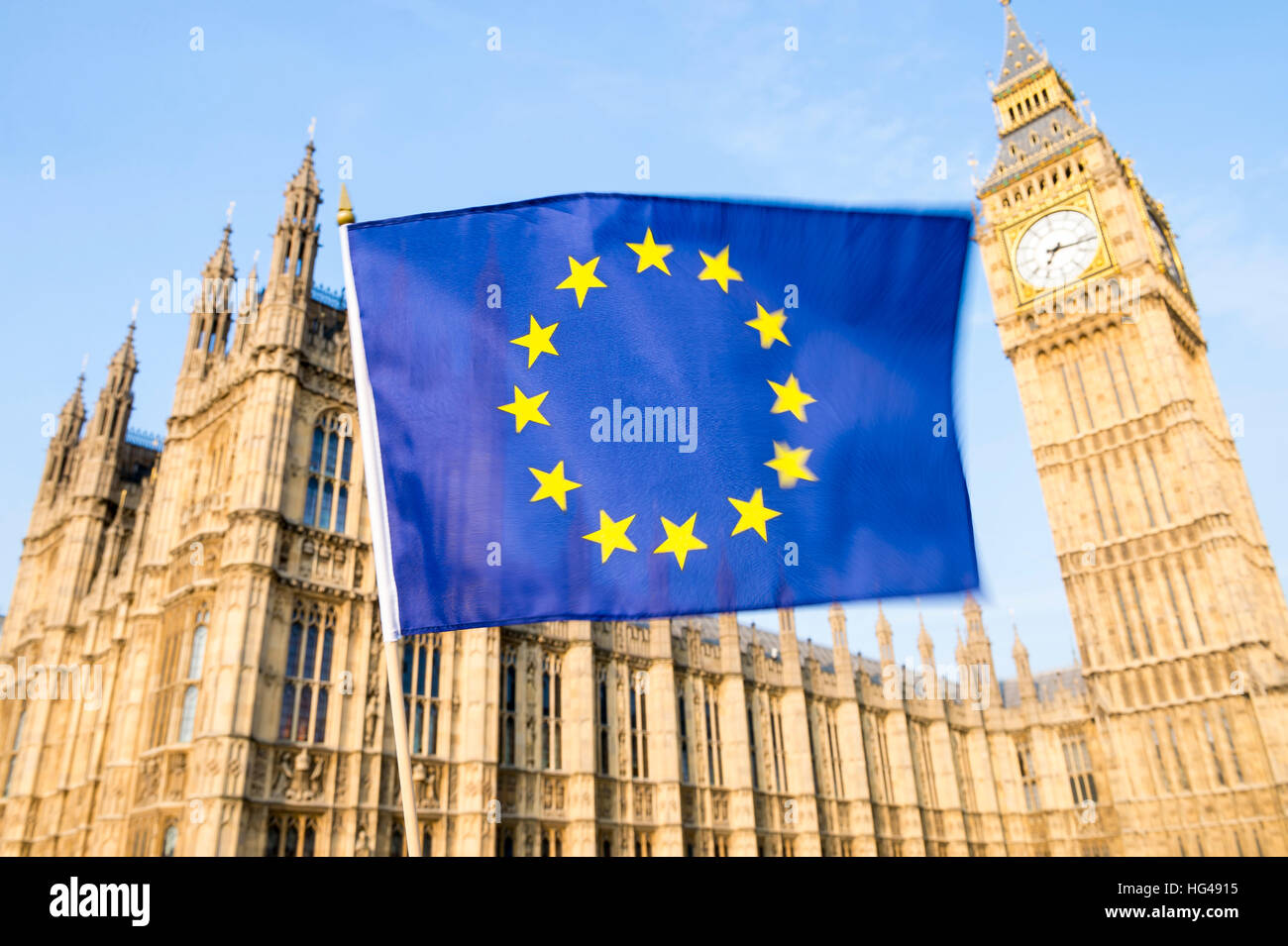 European Union flag flying in front of the Houses of Westminster in London - Stock Image