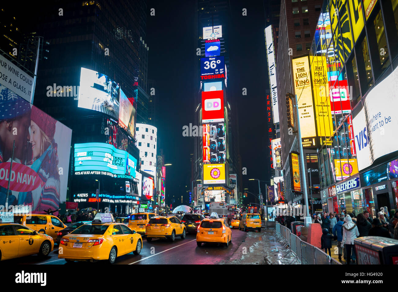 NEW YORK CITY - DECEMBER 17, 2016: Traffic and crowd fill Times Square as the city prepares for New Year's Eve. - Stock Image