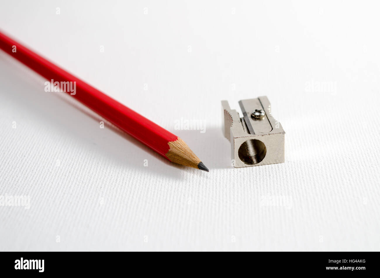 A Studio Photograph of a Pencil and a Pencil Sharpener - Stock Image