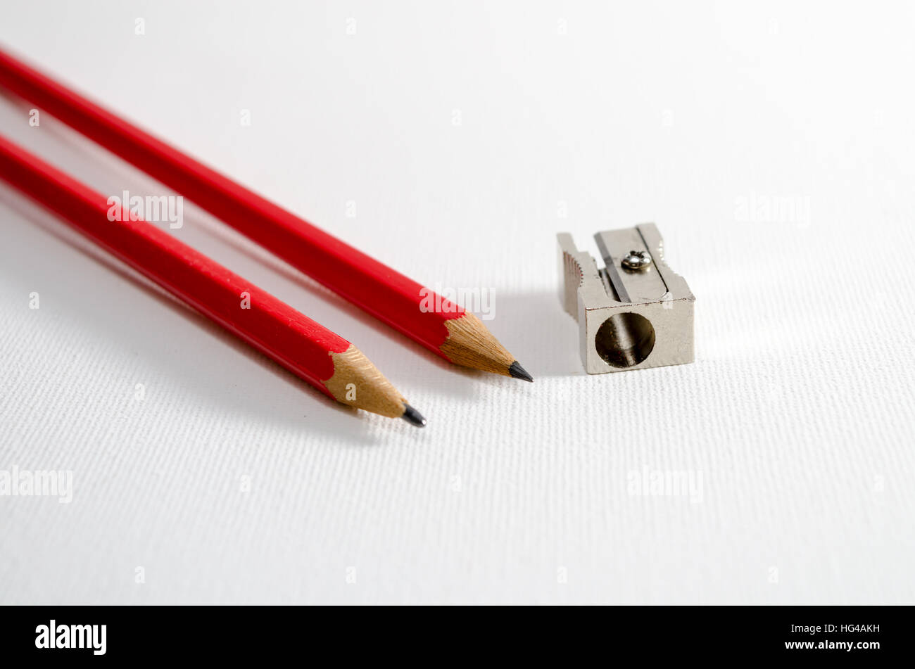A Studio Photograph of some Pencils and a Pencil Sharpener - Stock Image