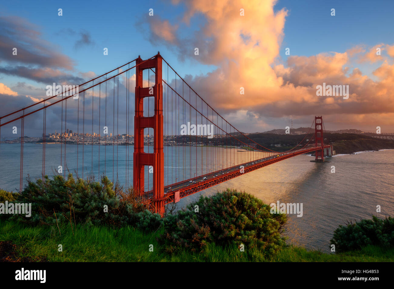 Beautiful Golden Gate the entrance to San Francisco, California, USA. Sunset and orange cloud in the sky. - Stock Image