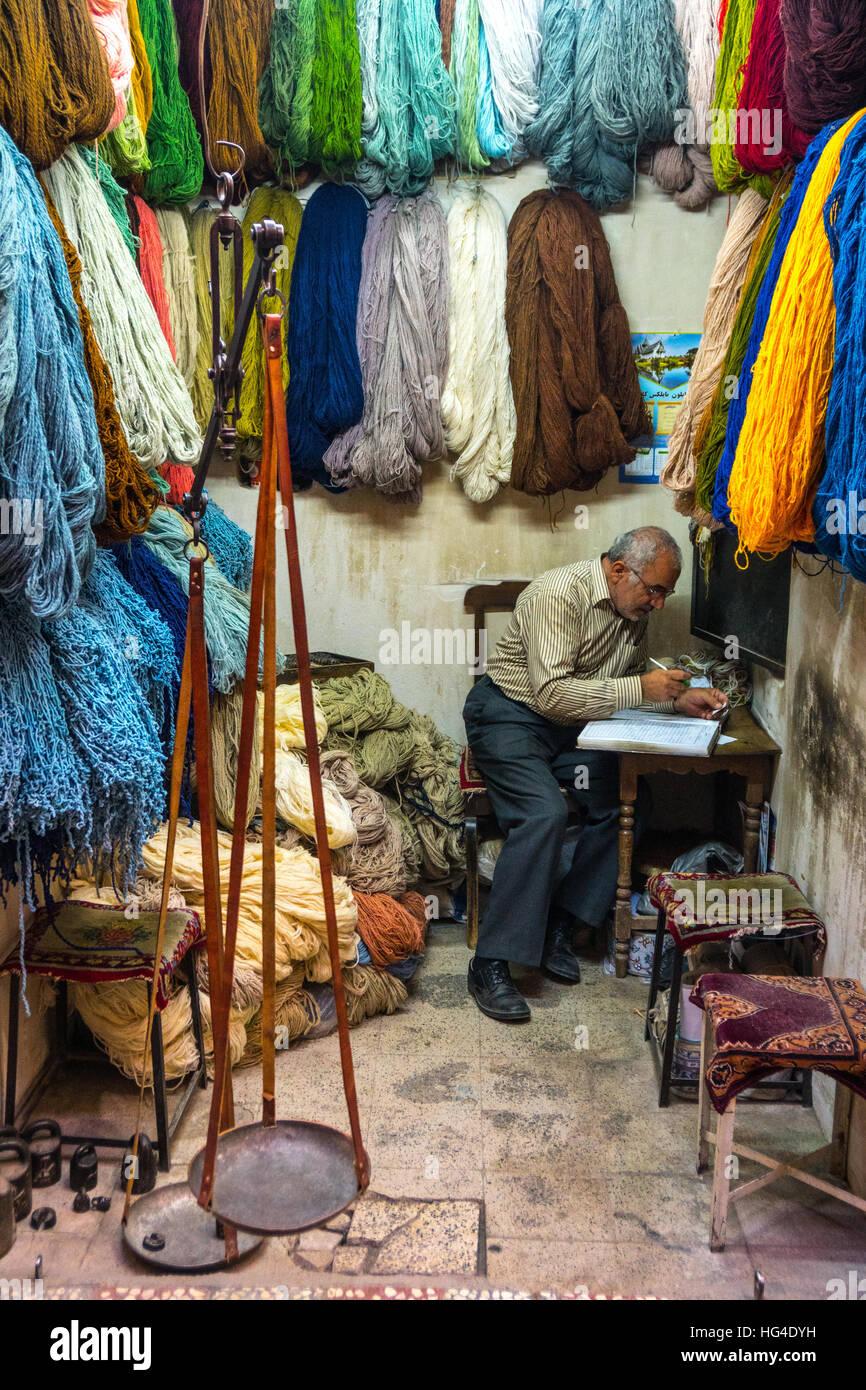 Carpet wool dealer, Old Bazaar, Kashan, Iran, Middle East - Stock Image