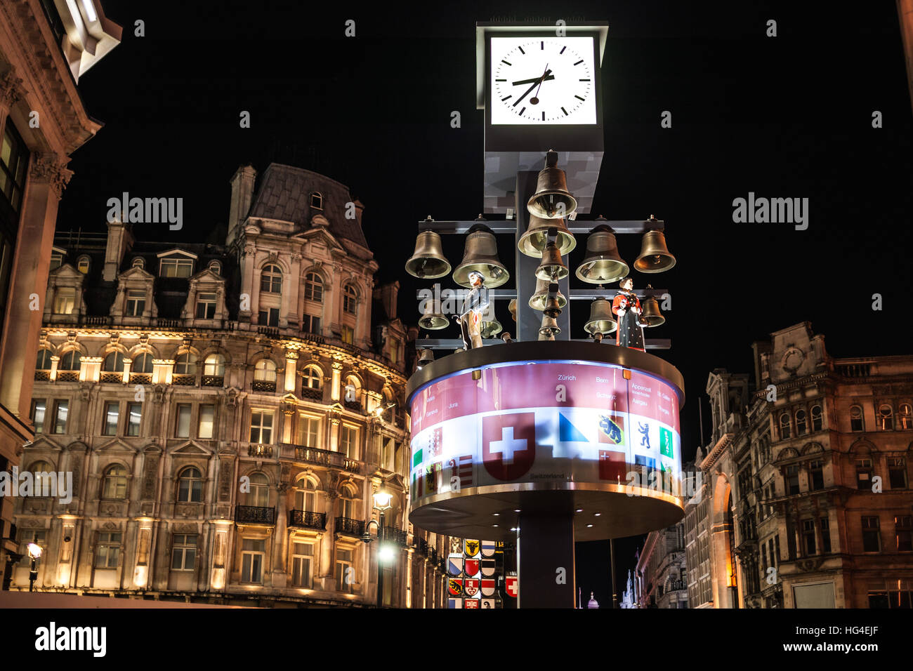 London UK, Swiss glockenspiel clock at night in Leicester Square Stock Photo