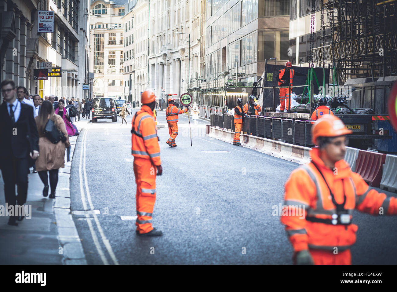 London UK, Workers blocking the road traffic for intervention Stock Photo