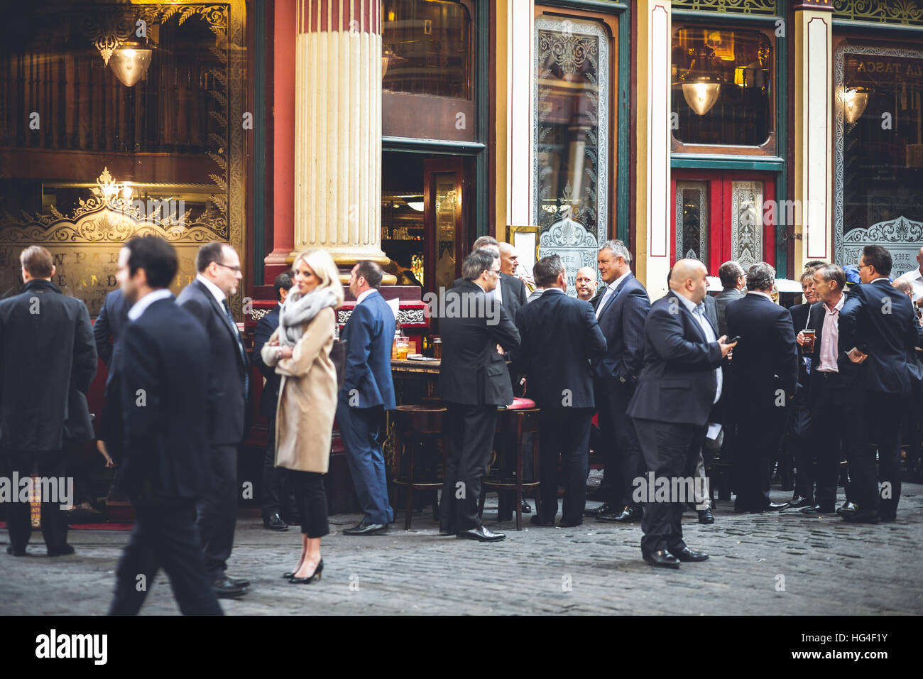 London Leadenhall Market, large group of business men socializes on a lunch break - Stock Image
