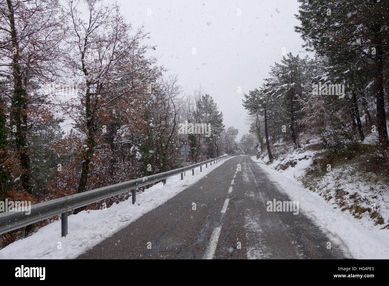 Road at winter, snowing - Stock Image