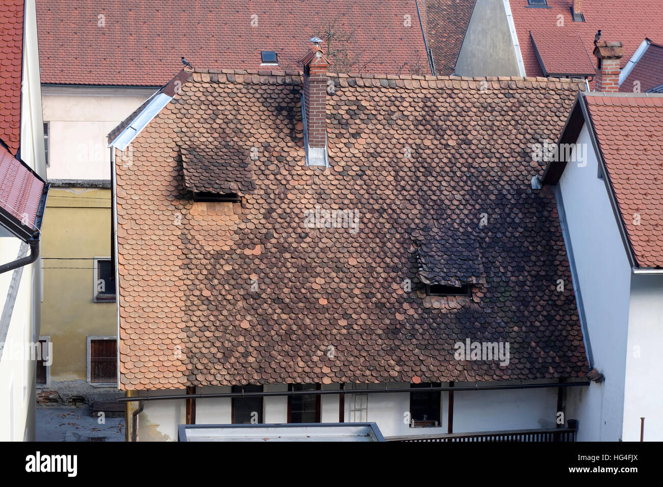 Medieval roof construction with openings for attic ventilation - Stock Image