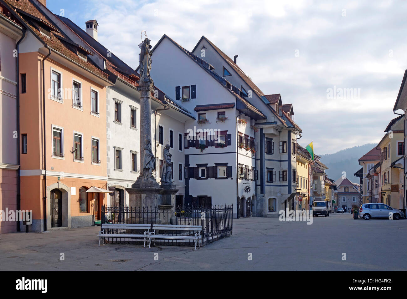 Street view  Mestni trg with Marian and Holy Trinity column (plague column), Skofja Loka, Slovenia . - Stock Image