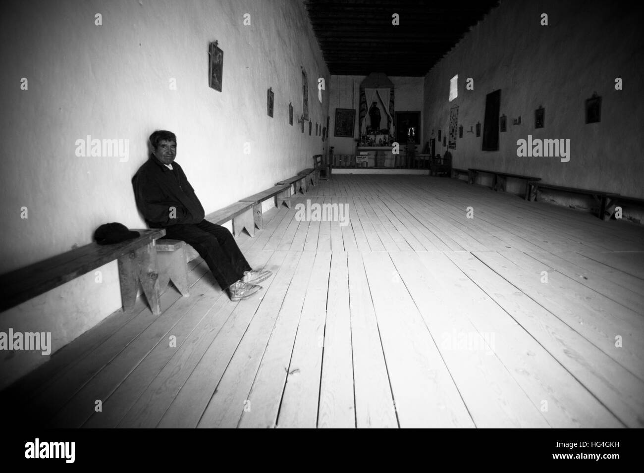 Man sitting in an empty church in Mexico - Stock Image
