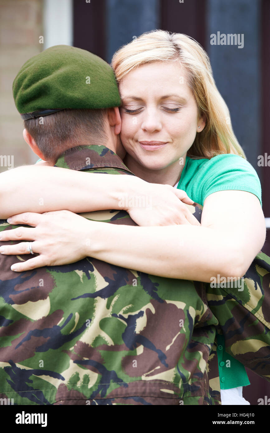 Wife Hugging Army Husband Home On Leave Stock Photo Alamy