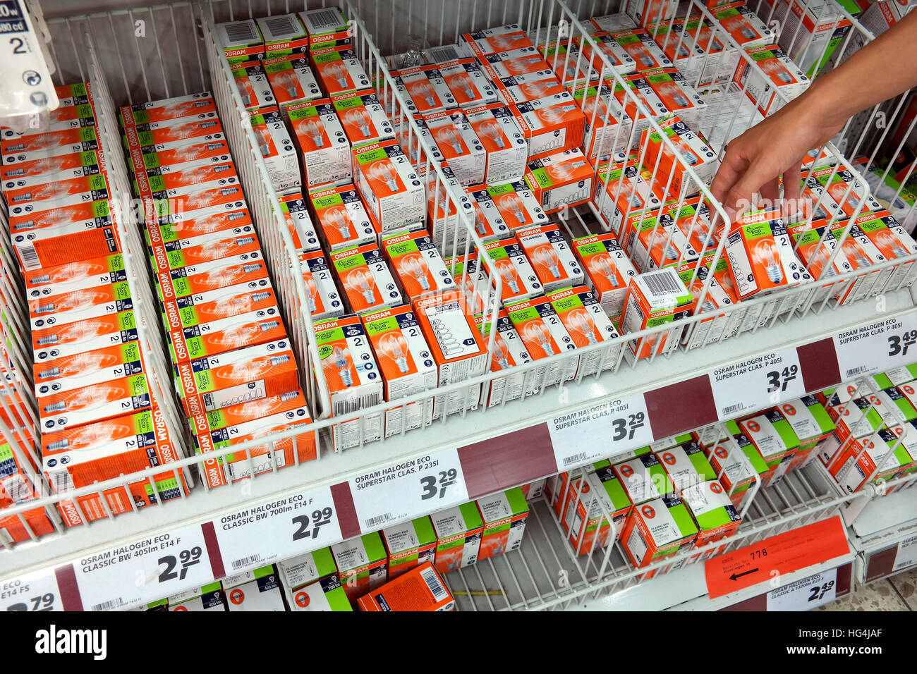 Shelves with Osram incandescent lamp packings. - Stock Image