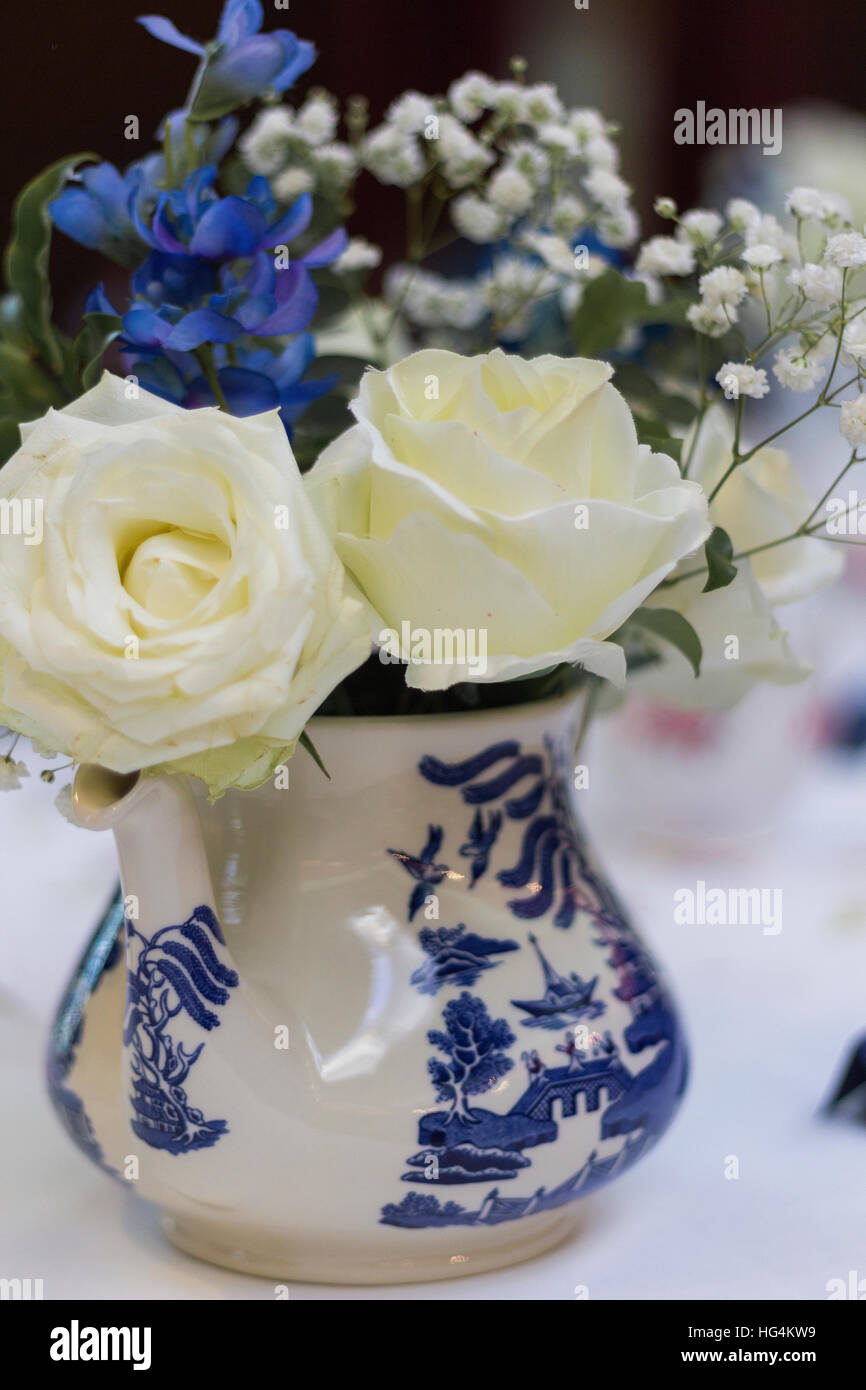 White Roses With Blue Flowers And Baby Breath In Blue And White