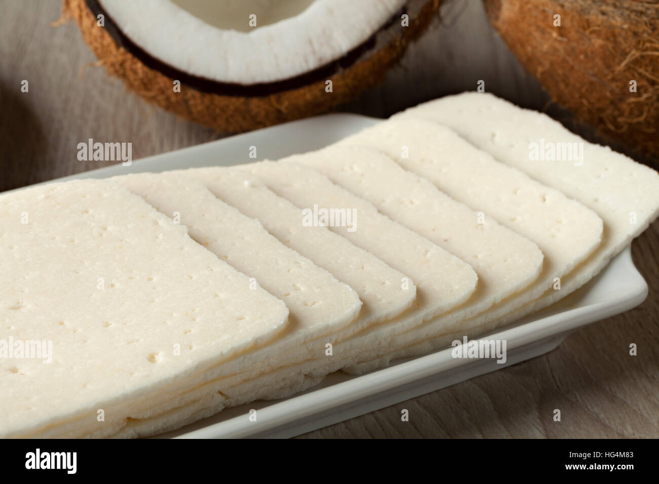 White sliced coconut sandwich filling - Stock Image