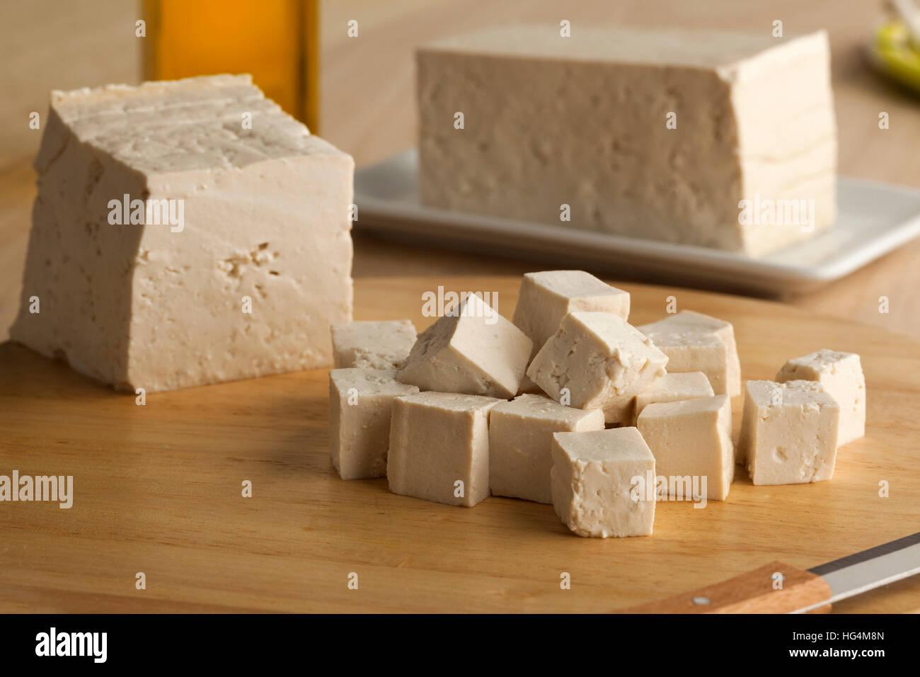 Fresh cut pieces of raw tofu - Stock Image
