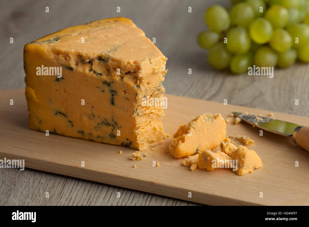 Piece of Shropshire blue cheese isolated on white background - Stock Image
