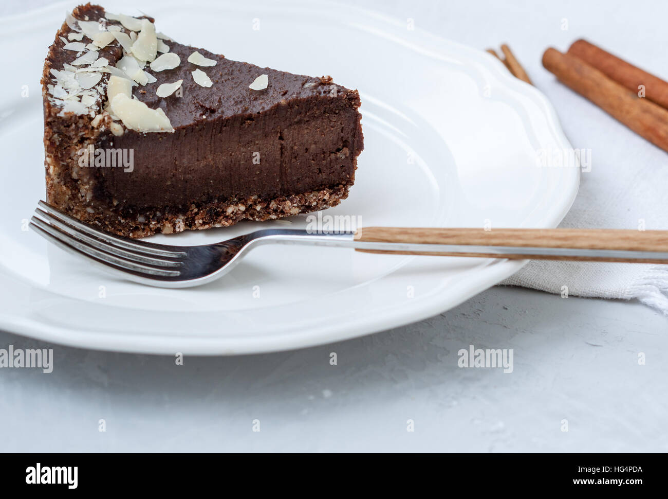 Chocolate raw vegan cake with nuts, figs and carob. Love for a healthy raw food concept. - Stock Image