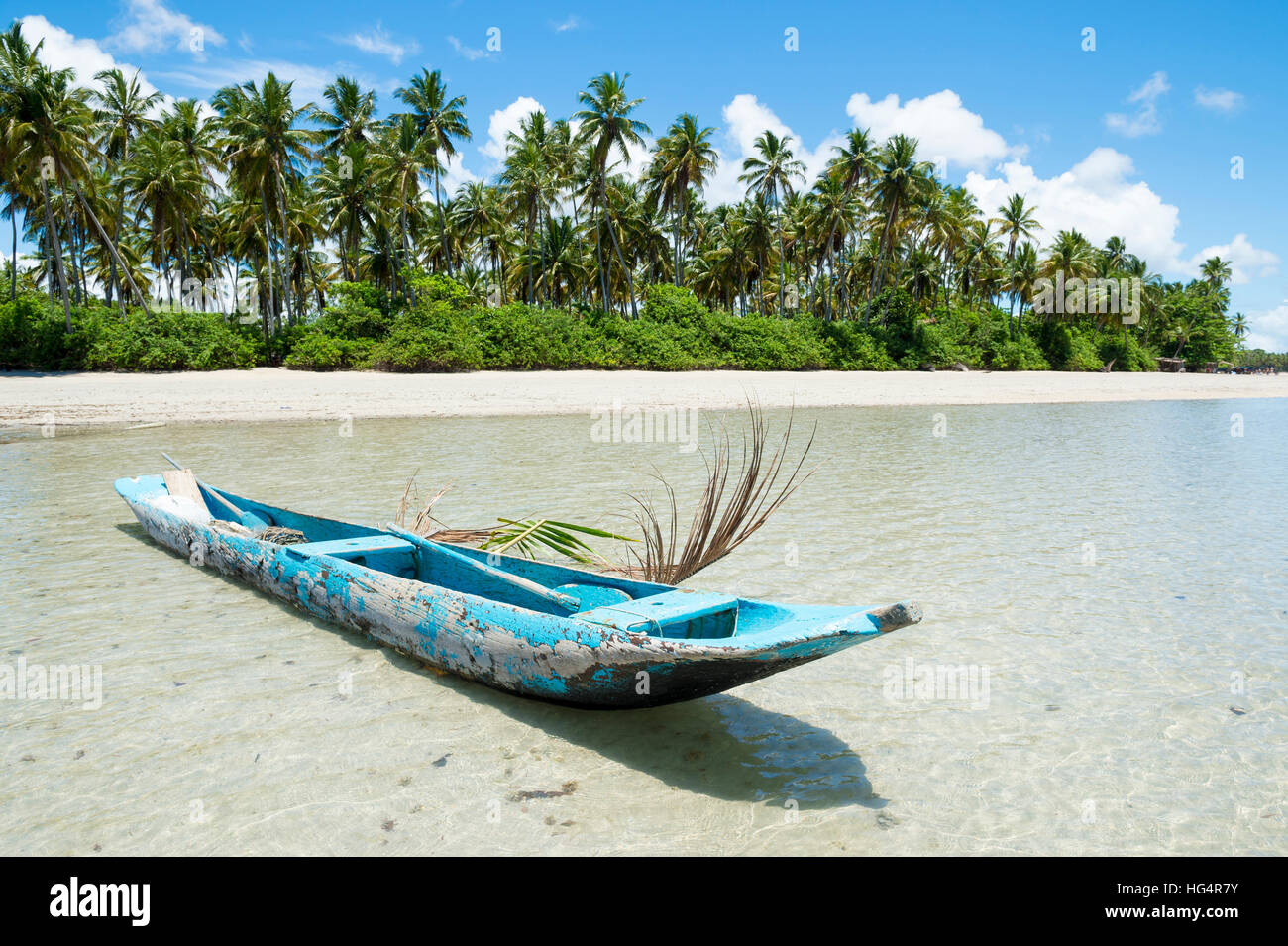 Weathered dugout canoe on remote beach in Bahia, Brazil - Stock Image