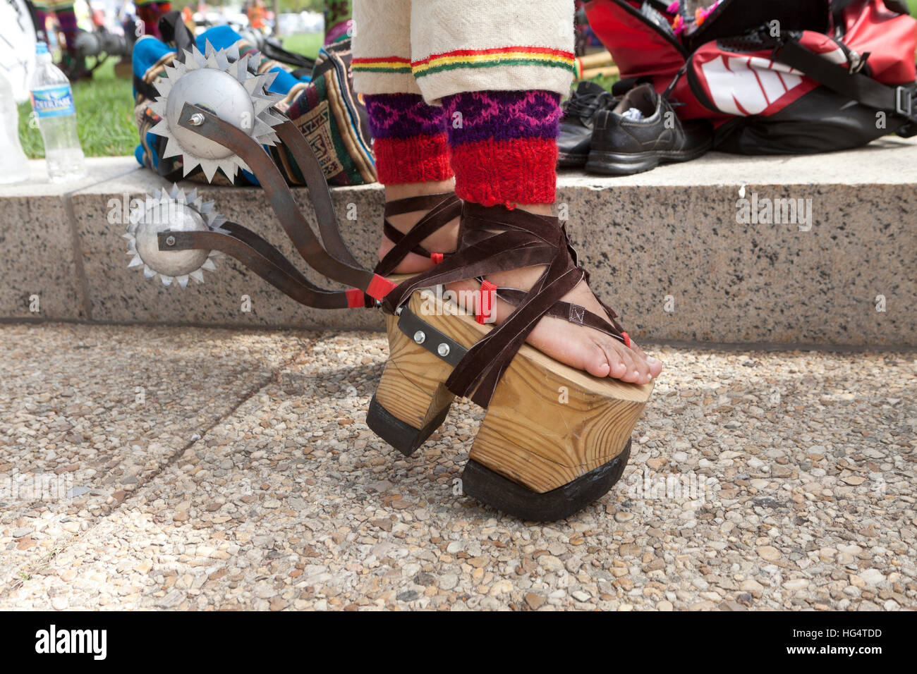 Wooden platform sandals and spurs on Pujllay dancer of the Quechuan people of Bolivia  - Washington, DC USA - Stock Image