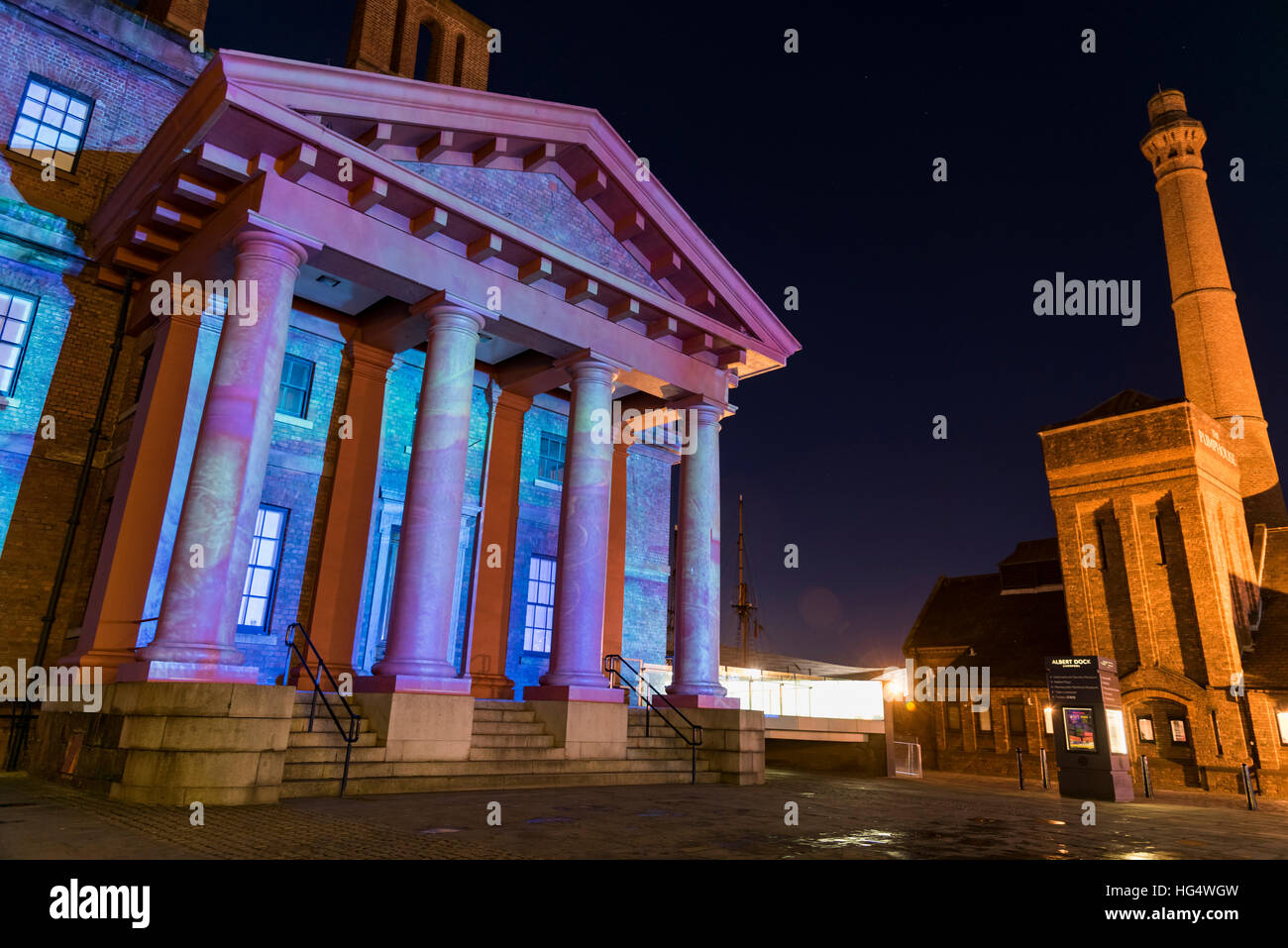 Floodlit iconic Grade I Listed Dr Martin Luther King Jr building (originally the Dock Traffic Office) in Liverpool - Stock Image
