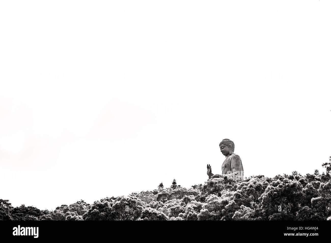 Black and white profile picture of Big Buddha on Lantau Island, Hong Kong - Stock Image