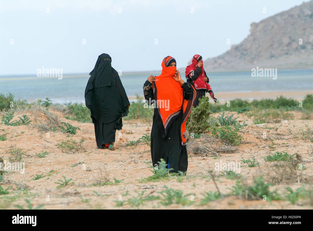 Socotra island, Yemen - 16 January 2008: women dressed in the burqa on the countryside of Socotra island, Yemen - Stock Image