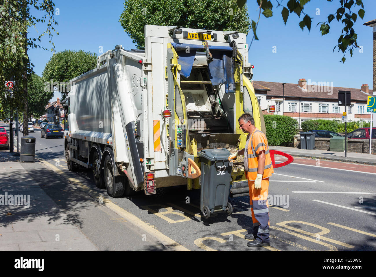Rubbish truck collection, Boston Manor Road, Brentford, London Borough of Hounslow, Greater London, England, United - Stock Image