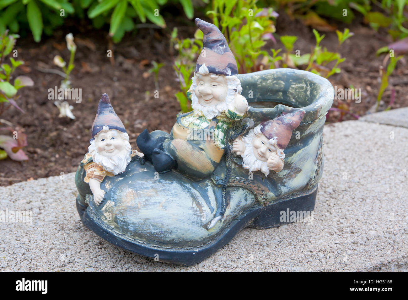funny garden gnomes sitting on the shoe stock image - Funny Garden Gnomes