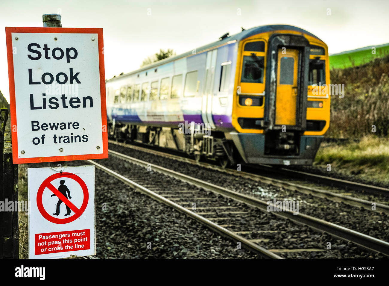 Train and warning sign on Settle Carlisle railway at Horton-in-Ribblesdale North Yorkshire - Stock Image