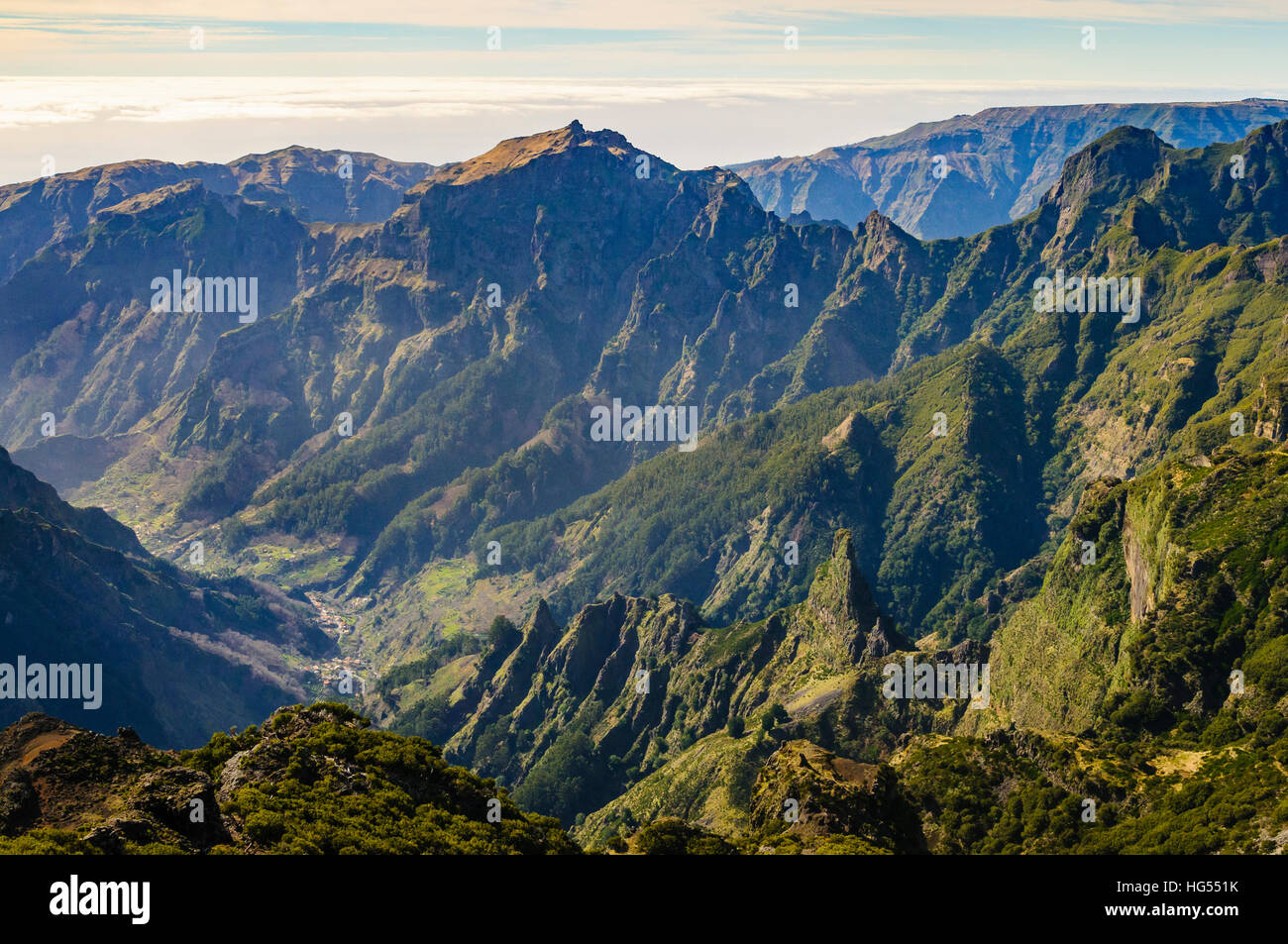 View from Pico Ruivo Madeira's highest summit with Curral das Freiras far below - Stock Image