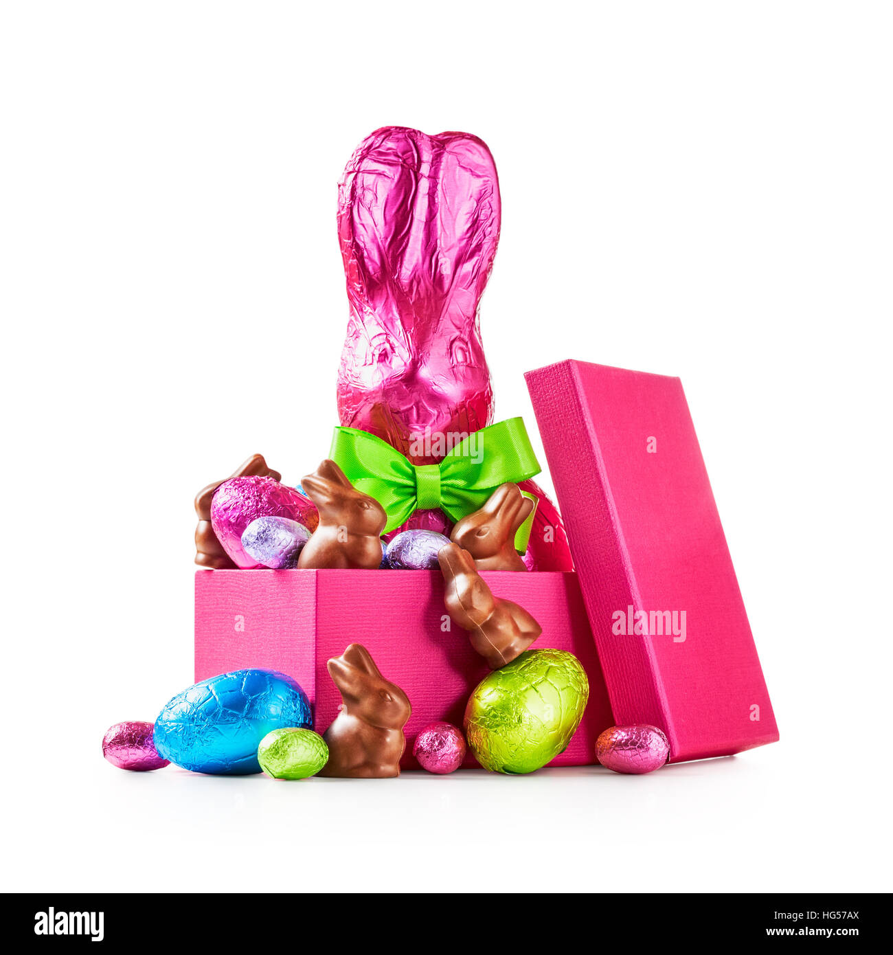 Gift box with chocolate easter eggs rabbit with bow wrapped in pink gift box with chocolate easter eggs rabbit with bow wrapped in pink foil bunnies and colorful candies isolated on white background clipping path negle Gallery
