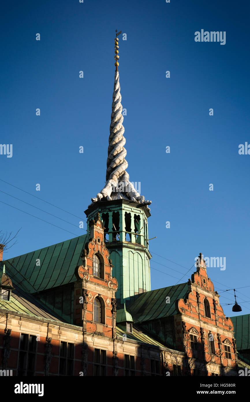 Denmark, Copenhagen, Slotholmsgade, twisted dragon spire of Borsen, the former stock exchange - Stock Image