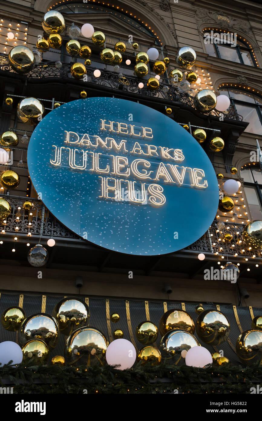Denmark, Copenhagen, Kongens Nytorv, Magazin du Nord, department store, Christmas Julecave Hus sign - Stock Image